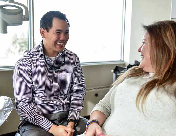 Calgary Dentist | Dr. Archie Tang Working on Patient